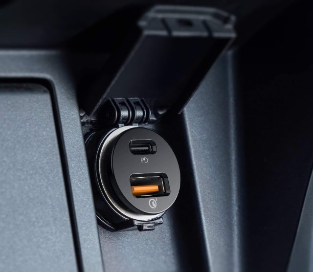 Image shows the USB car charger in use.