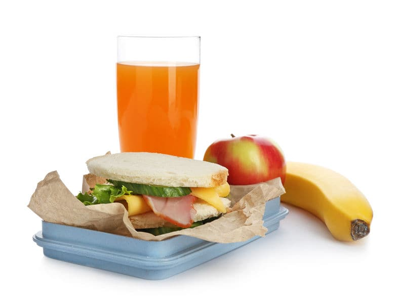 This photo shows a healthy lunch with a veggie sandwich, fresh fruit and juice, for eating back at the hotel.