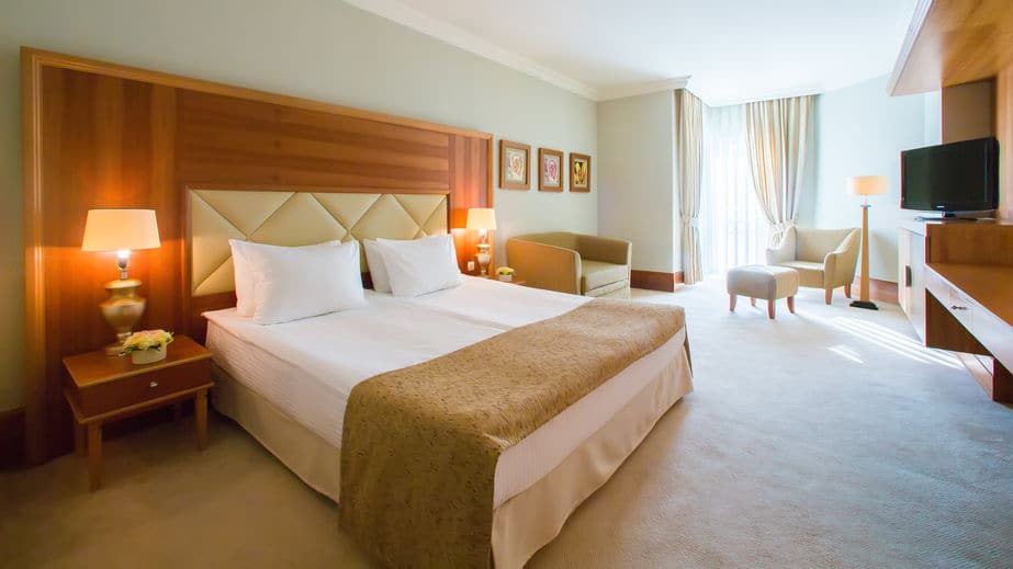 This photo shows a four star hotel room interior, ready for the guest.