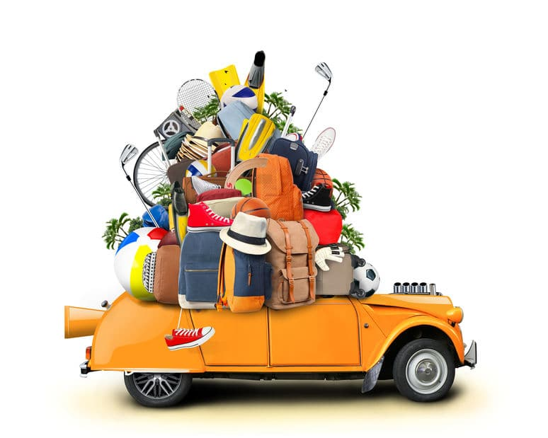 This is a comical illustration of a car, luggage piled high on top of it, ready for a road trip.