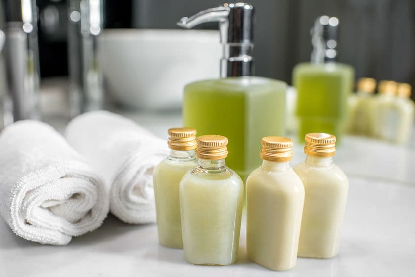 This photo shows bottles of premium shampoo and conditioner in a hotel room, which are paid, not a freebie or complimentary.